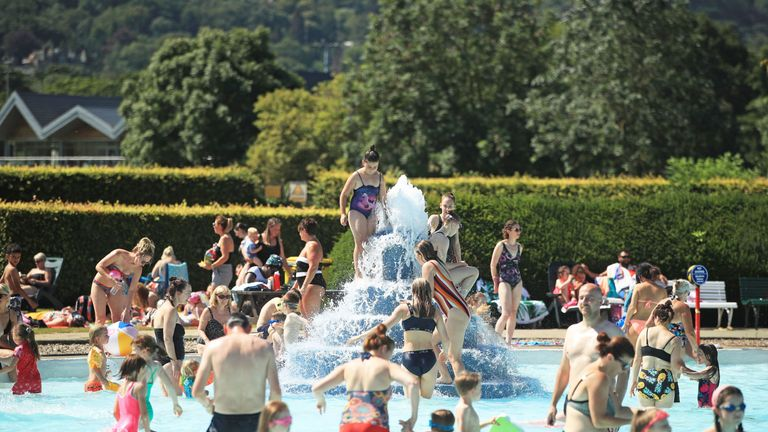 People play in the water at Ilkley outdoor pool and lido in West Yorkshire