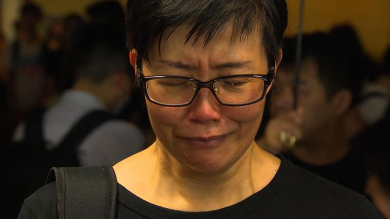 A woman grieves at a memorial to one of those who died