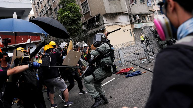 Demonstrators clash with police during a protest in Hong Kong