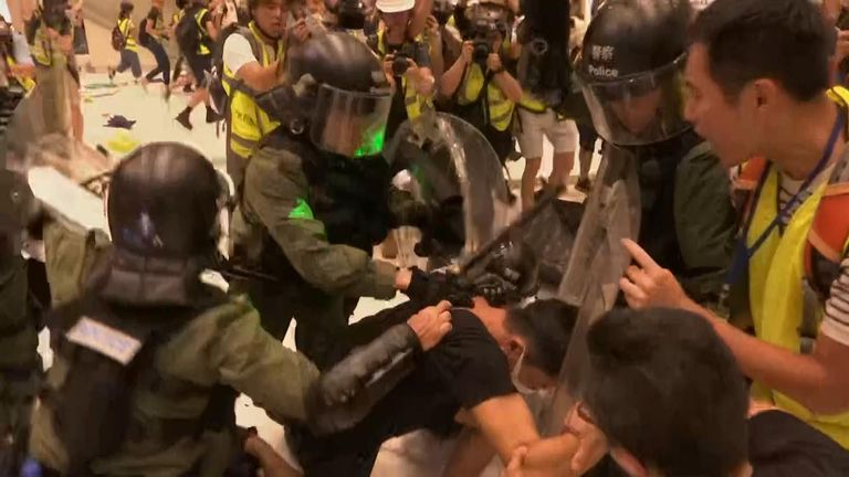 Chaos in shopping mall after Hong Kong police move to clear protesters after hours-long stand-off as extradition bill rally turns violent.