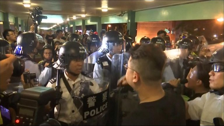 Police in riot helmets and wielding large shields swept through the town of Sheung Shui late on Saturday (July 13), reclaiming the streets after protests turned to unrest.