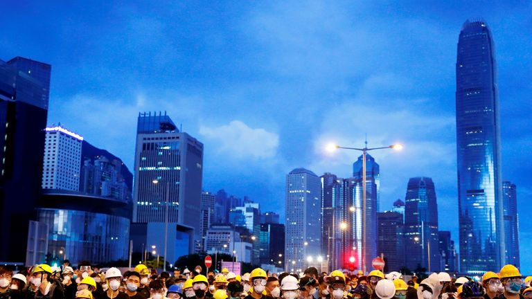 Anti-extradition bill protesters stand behind a barricade during a demonstration near a flag raising ceremony for the anniversary of Hong Kong handover to China in Hong Kong, China July 1