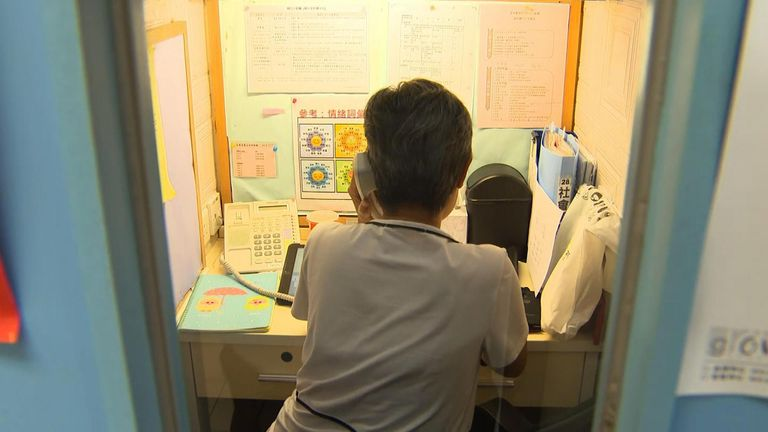 A charity worker mans a telephone help line to help people wanting to take their own lives.