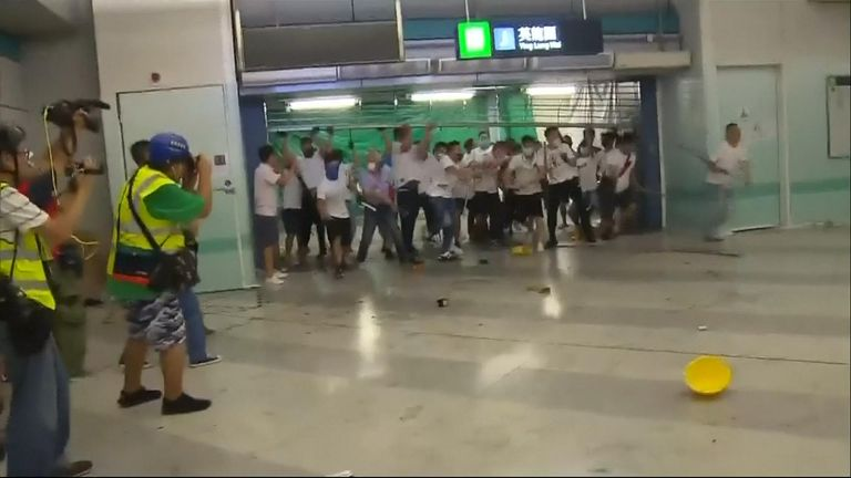 Anti-government protesters were attacked at a train station after demonstrations over an extradition bill to send people to China for trial.