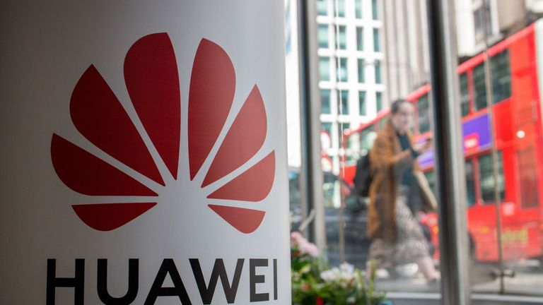 A pedestrian walks past a Huawei product stand at an EE telecommunications shop in central London on April 29, 2019. - British Foreign Secretary Jeremy Hunt has urged caution over the role of China's Huawei in the UK, saying the government should think carefully before opening its doors to the technology giant to develop next-generation 5G mobile networks. His comments come after Prime Minister Theresa May conditionally allowed China's Huawei to build the UK 5G network, information that was leak