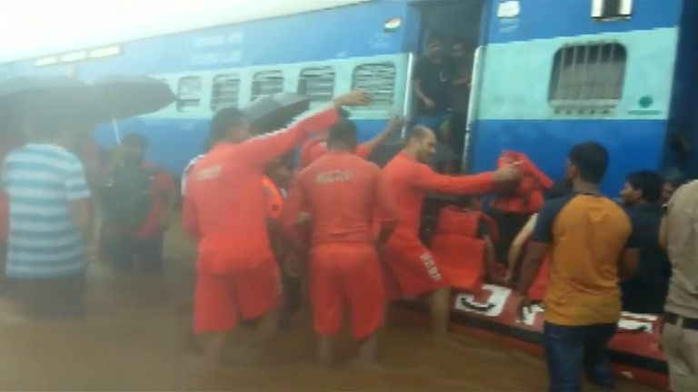 700 passengers rescued from a flooded train in India.