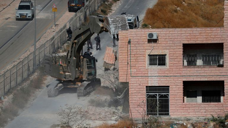 Israeli security forces demolishing a building which was earlier evacuated of its residents as they demolish the Palestinian buildings, some still under construction, which have been issued notices to be demolished in the Wadi al-Hummus area adjacent to the Palestinian village of Sur Baher