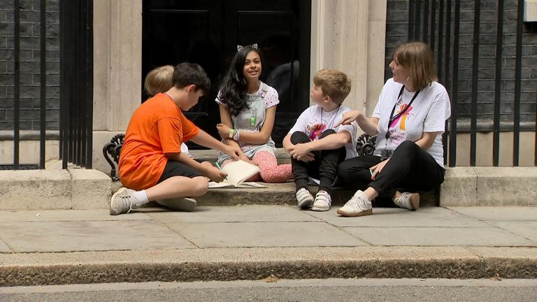 Jess Phillips with Danny (far left) and other children protesting over school cuts