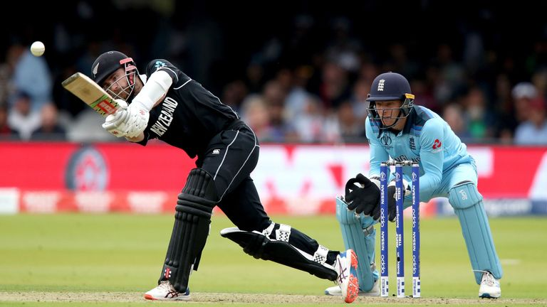 New Zealand's Kane Williamson (left) in batting action as England's wicketkeeper Jos Buttler looks on