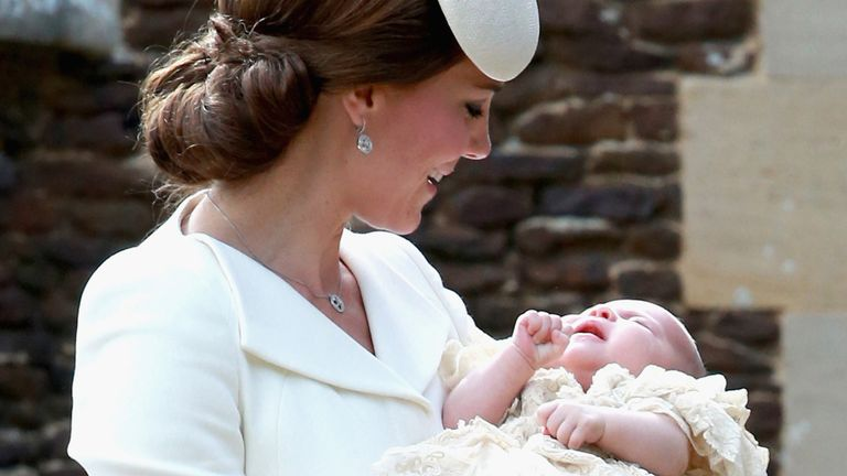Catherine, Duchess of Cambridge and Princess Charlotte of Cambridge arrive at the Church of St Mary Magdalene on the Sandringham Estate for the Christening of Princess Charlotte of Cambridge on July 5, 2015