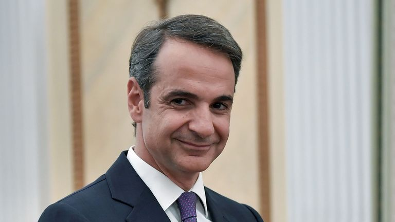 Leader of New Democracy conservative party and winner of Greek general election Kyriakos Mitsotakis smiles during his swearing-in ceremony as a prime minister of Greece at the presidental palace in Athens on July 8, 2019. - Greece's new prime minister, Kyriakos Mitsotakis, formally takes up the reins on July 8, a day after an election victory that puts him in charge of the EU's most indebted member with promises to end a decade of economic crisis. (Photo by Louisa GOULIAMAKI / AFP) (Photo credit