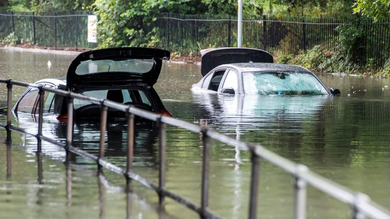 Cars trapped in floodwater near Levenshulme in Manchester