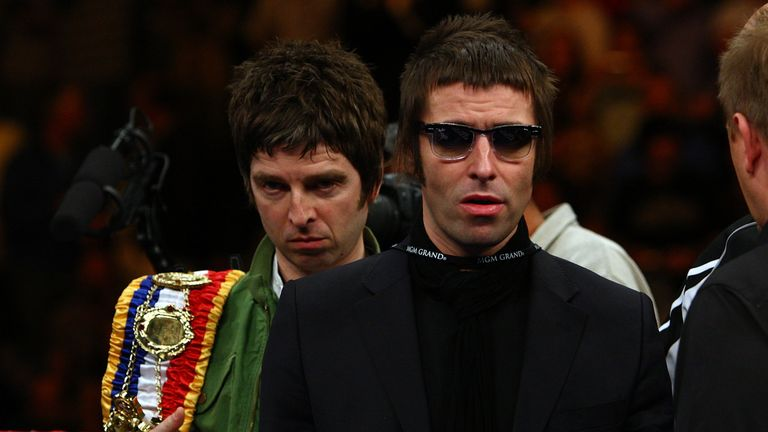 Noel and Liam Gallagher of Oasis bring out boxer Ricky Hatton of England's belts