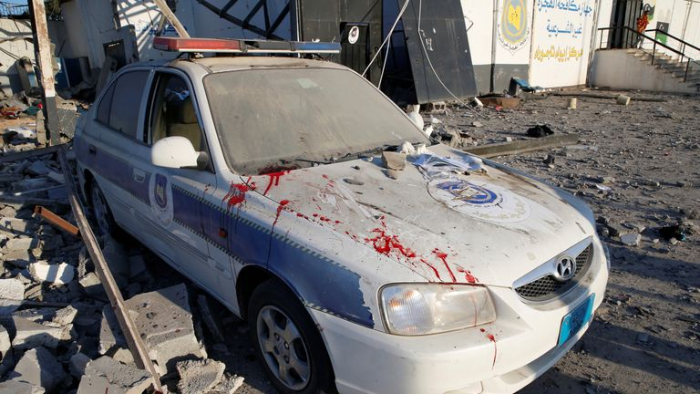 A police car at a detention centre for mainly African migrants, hit by an airstrike in the Tajoura suburb of Tripoli, Libya