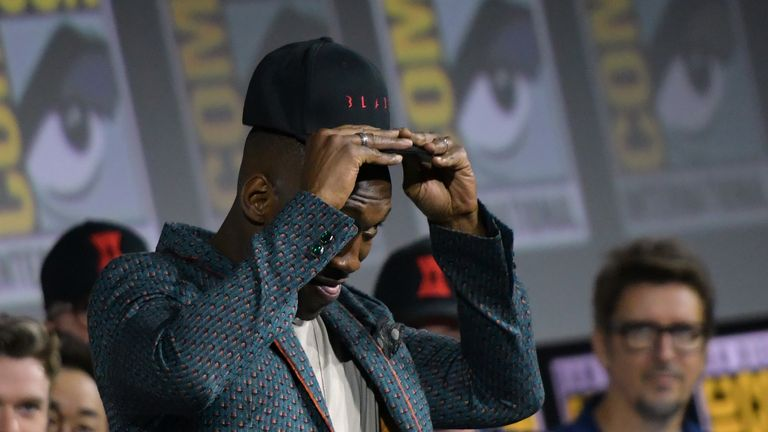 "US actor Mahershala Ali puts on a ""Blade"" hat on stage during the Marvel panel in Hall H of the Convention Center during Comic Con in San Diego, California on July 20, 2019."