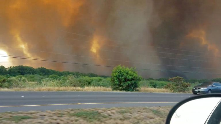 Smoke and flames seen from a road in Maui. Pic: Drumnicodotcom