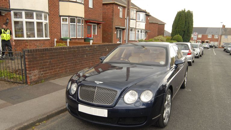 A Bentley parked outside a house linked to the modern slavery ring