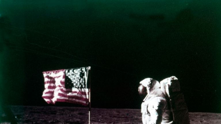 Aldrin stands next to the US flag placed on the moon