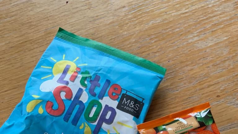 "Marks and Spencer says it is ""committed to reducing"" its use of plastic after customers criticsed a new campaign in which they give away plastic toy versions of their most popular products."