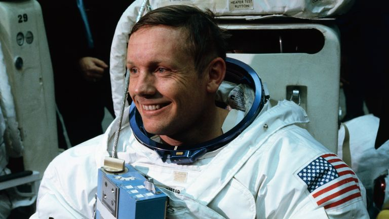 1969 Original Caption) Space Center, Houston: Astronaut Neil A. Armstrong, in training for the projected Apollo 11 lunar landing mission, is being suited up for the first full dress rehearsal of activities he is to perform during the projected moon landing.
