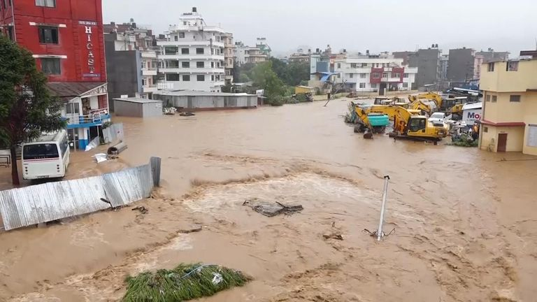 Flood waters flowing through a residential area of Kathmandu