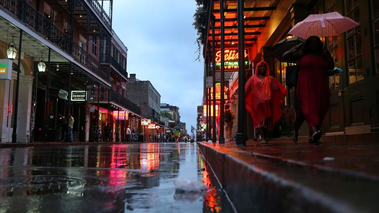 Tourists walk on Bourbon St. during Hurricane Barry in New Orleans, Louisiana, U.S. July 13, 2019