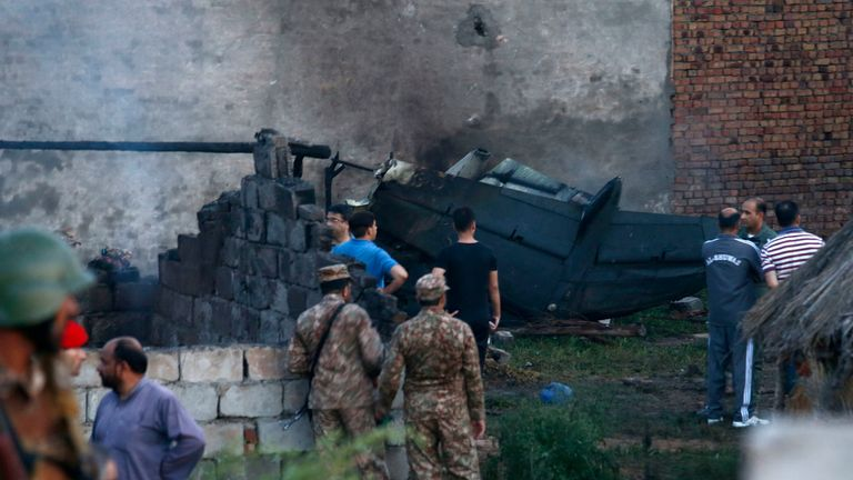 At least 17 dead, including children, as army plane crashes into homes