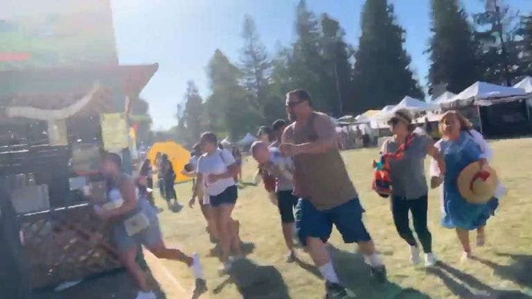 People run away after shooting at Gilroy Garlic Festival. Pic: @wavyia