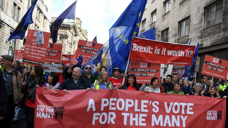 Anti-Brexit protesters hold placards as they take part in an anti-Brexit, pro-EU march through the centre of Liverpool, north west England on September 23, 2018, in support of a People's Vote, on the official opening day of the annual Labour Party Conference. (Photo by Paul ELLIS / AFP)        (Photo credit should read PAUL ELLIS/AFP/Getty Images)