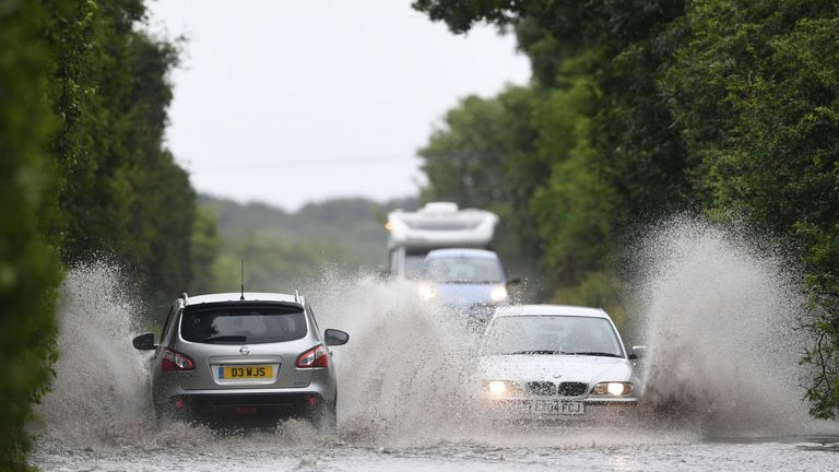 Cars driving through standing water on the A47 near Peterborough on Sunday