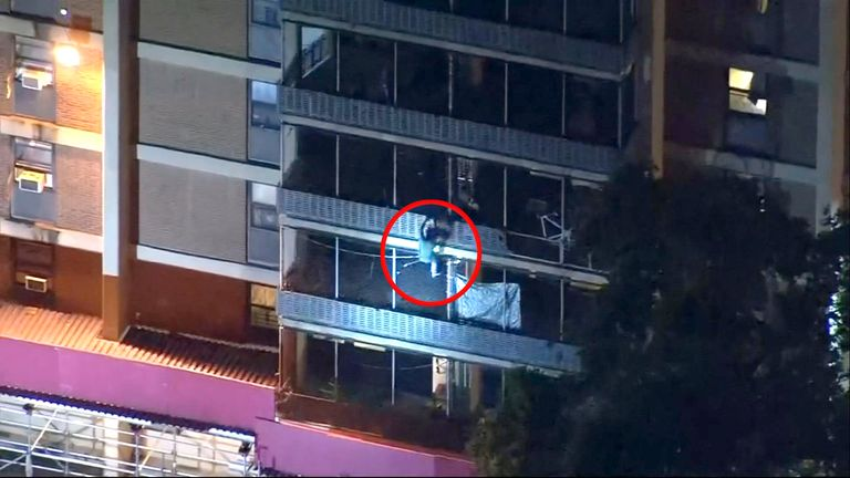 Man scales down high-rise building to escape fire