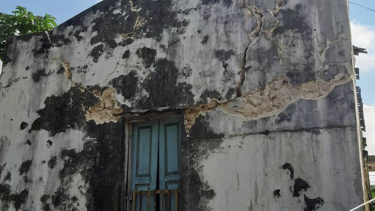 Cracks are seen on the facade of a building after an earthquake struck the Batanes Province, in northern...