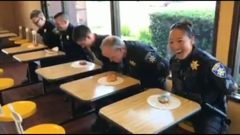 Police officers in California embraced stereotypes associated with their profession as they trained for a doughnut-eating contest.