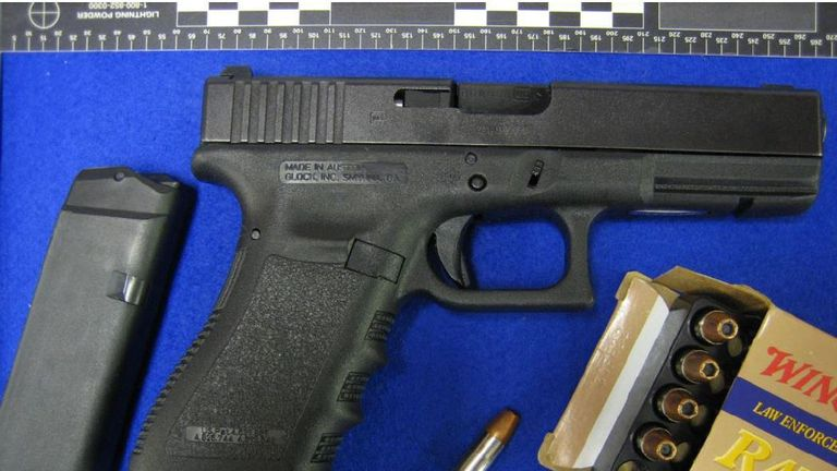 A Glock pistol and ammunition shown in evidence during the trial
