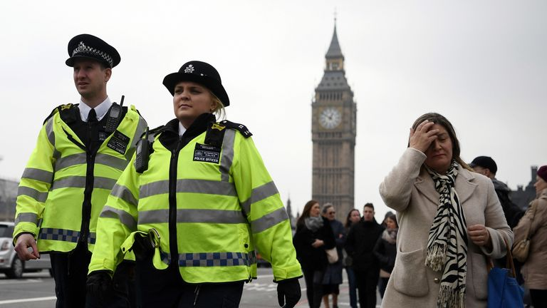 LONDON, ENGLAND - MARCH 24: Police officers patrol on Westminster Bridge on March 24, 2017 in London, England. A fourth person has died after Khalid Masood drove a car into pedestrians on Westminster Bridge before going on to fatally stab PC Keith Palmer on March 22. (Photo by Carl Court/Getty Images)