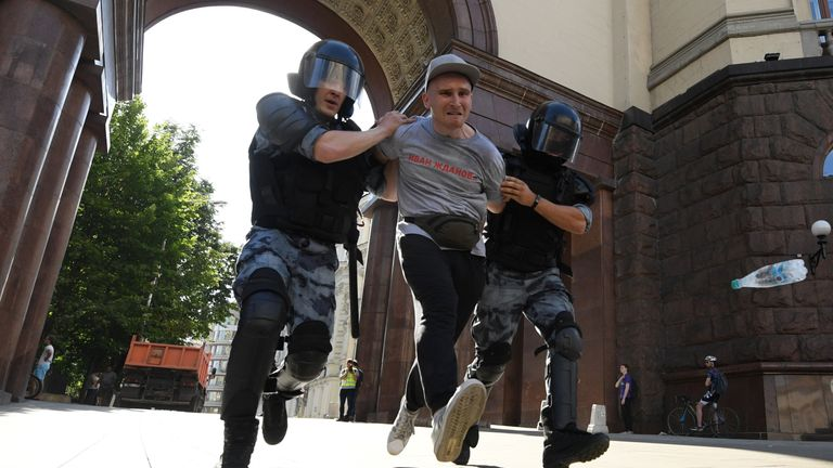 Riot police detaining a protester in Moscow