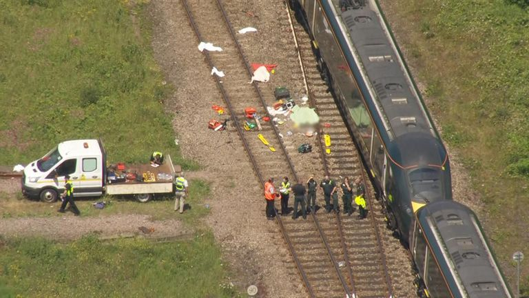 Two railway workers killed after being hit by train 'could not hear