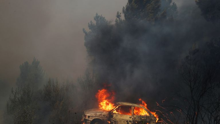 A car burns near at the small village of Vila de Rei, Portugal
