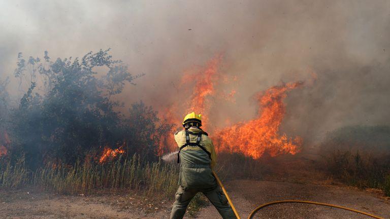 A firefighter tackles the blaze in Vila de Rei