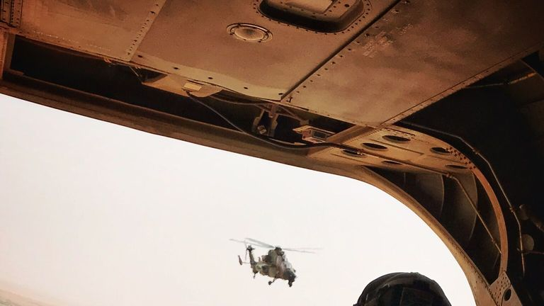 Two RAF Chinooks flying low over Mali delivering troops and equipment to French forces