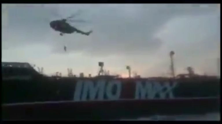 Footage released by Iran shows armed troops rappelling onto the ship from a helicopter