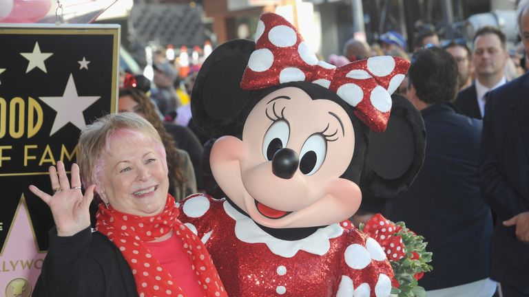 Russi Taylor, who has voiced Minnie Mouse since 1986, poses with Minnie Mouse during a star ceremony in celebration of the 90th anniversary of Disney's Minnie Mouse at the Hollywood Walk of Fame on January 22, 2018 in Hollywood, California