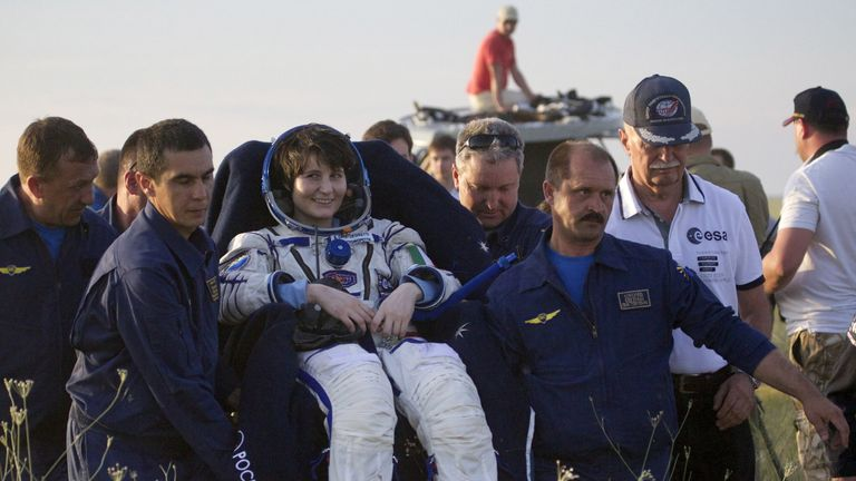 Ground personnel carry International Space Station (ISS) crew member Samantha Cristoforetti of Italy shortly after landing near the town of Zhezkazgan, Kazakhstan, June 11, 2015