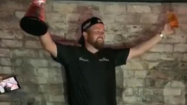 Shane Lowry celebrates after winning golf's Open Championship