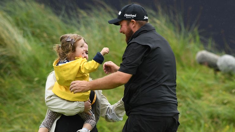 Lowry was embraced by his wife and daughter after securing his first major golfing title