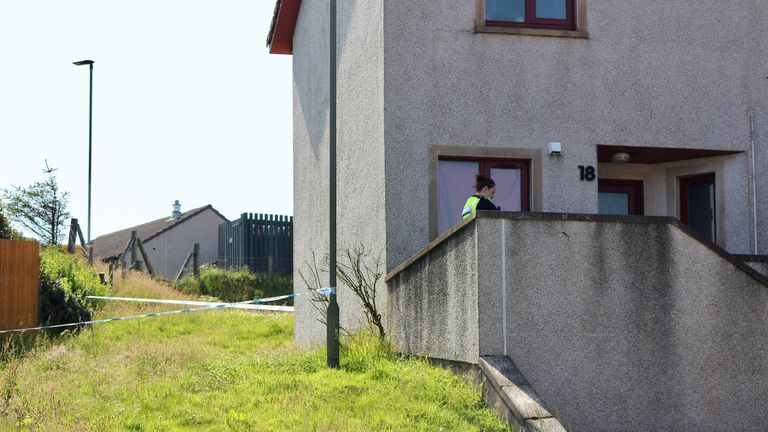 The woman was found outside a house on Ladies Drive