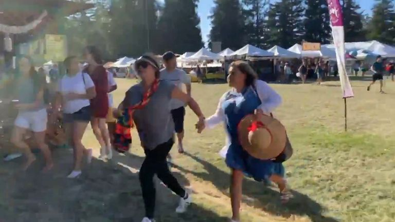 People run away after shooting at Gilroy Garlic Festival. Pic: @wavyia.