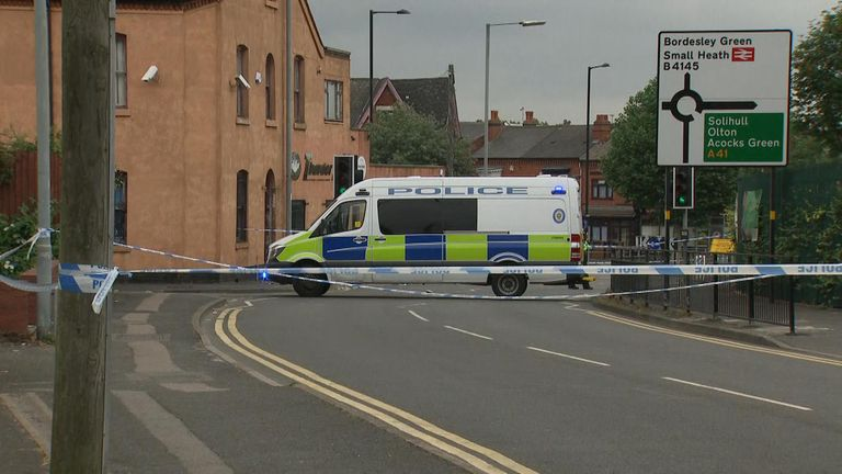 A police cordon is in place around the crime scene