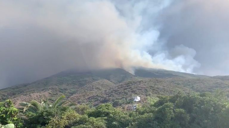 Ash and smoke rise after a volcano eruption started wildfires in Stromboli, Italy on Wednesday