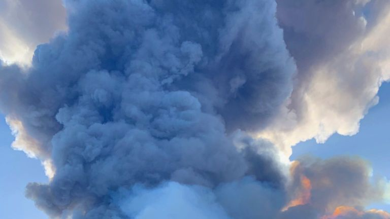 The eruption sent a plume of smoke billowing into the sky